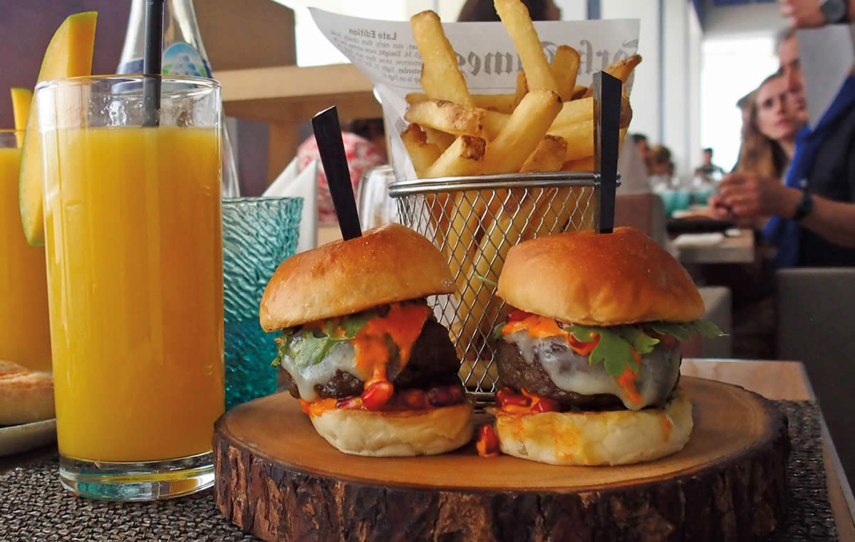 Camel sliders and fries with mango juice at Louvre Abu Dhabi café.