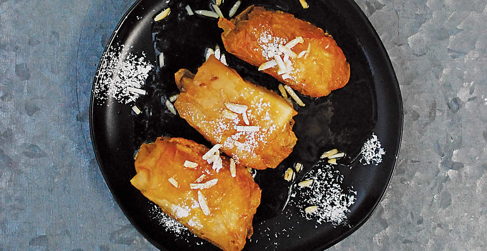 Flavors: Cheese Parcels with Honey and Orange Reduction