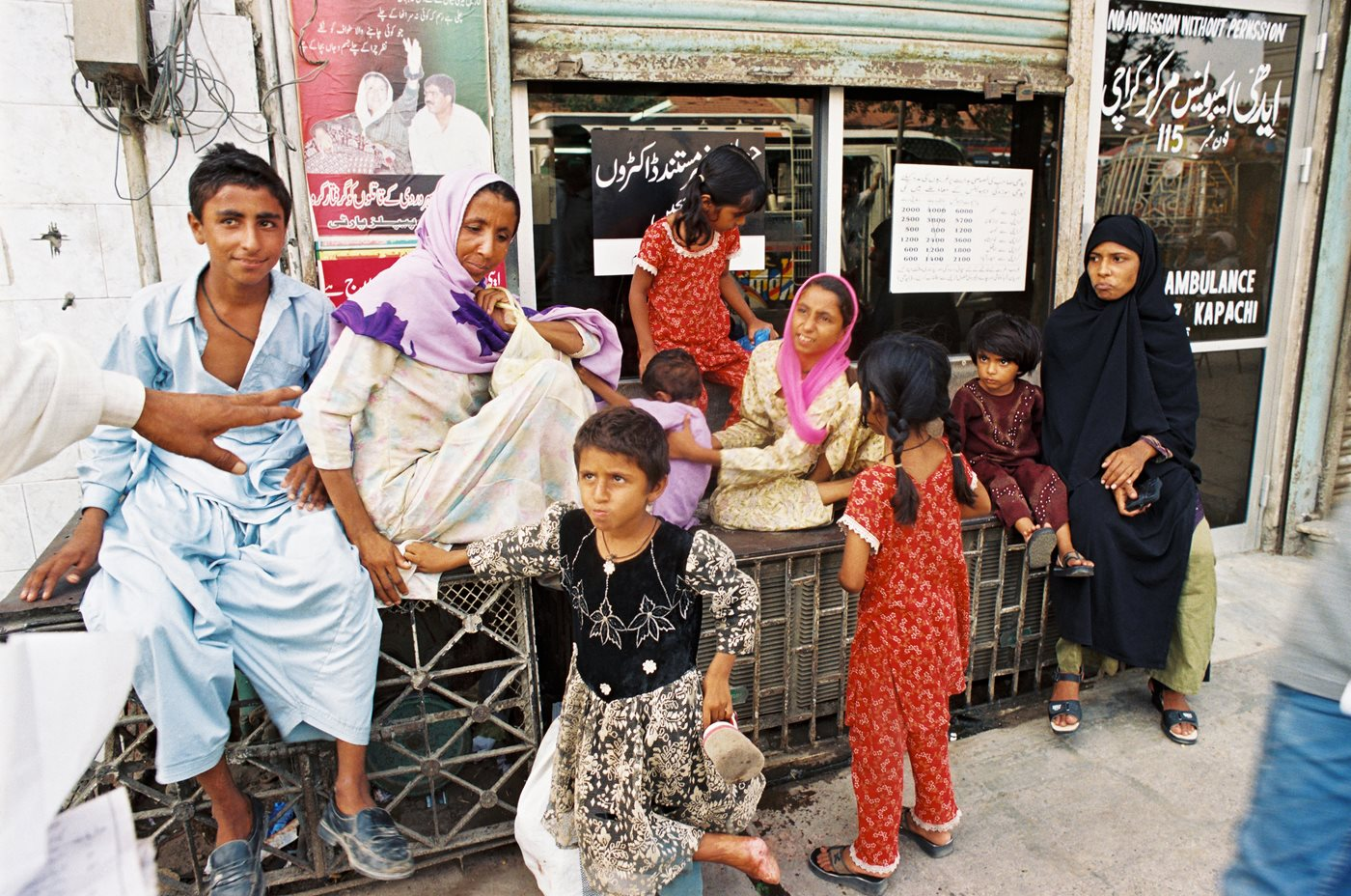 A Woman Abandoned By Her Husband Waits With Her Children Outside An Edhi  Center She Will Ask The Foundation's Help In Securing Alimony